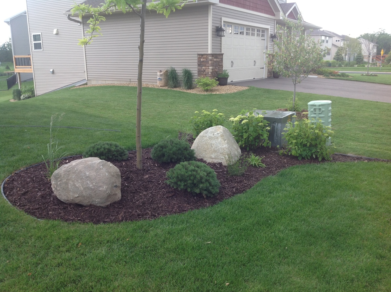 Groundwrx landscape hardscape design plymouth mn for Landscaping rocks new plymouth